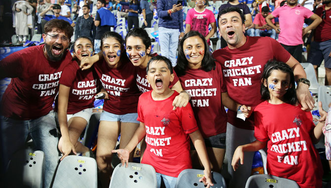 Fans enjoy during match fourteen of the Vivo Indian Premier League 2018 (IPL 2018) between the Mumbai Indians and the Royal Challengers Bangalore