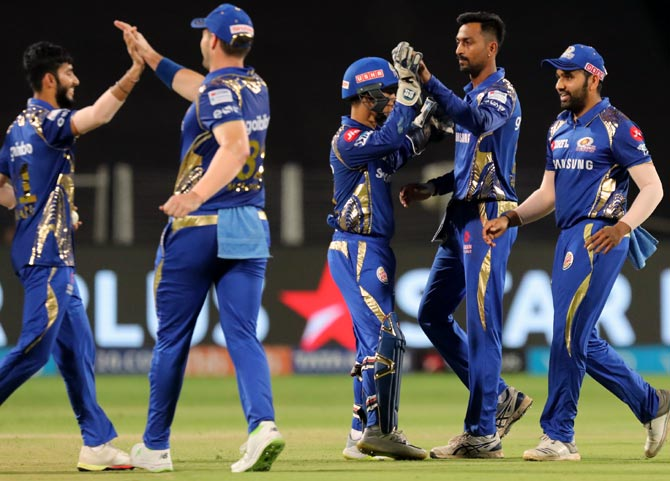 Mumbai Indians players celebrate the wicket of Shane Watson