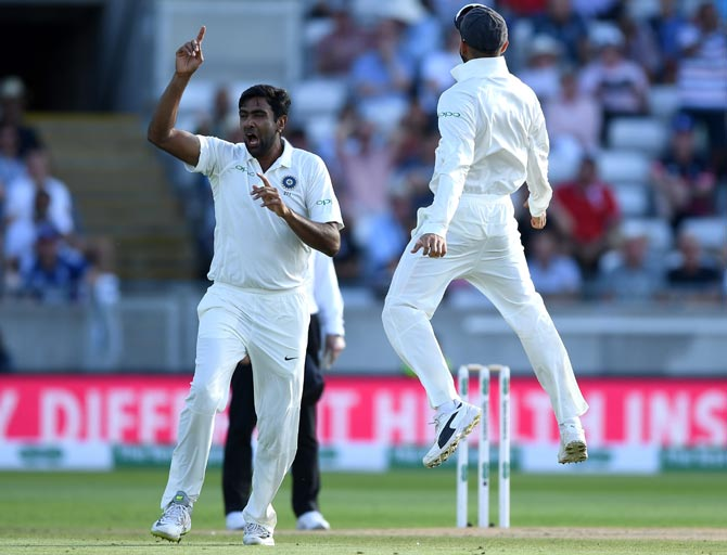 Ravichandran Ashwin, left, celebrates with Virat Kohli after dismissing Alastair Cook in the first innings