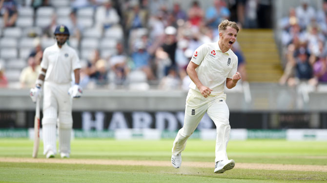 Sam Curran celebrates after claiming the wicket of Lokesh Rahul in the first innings