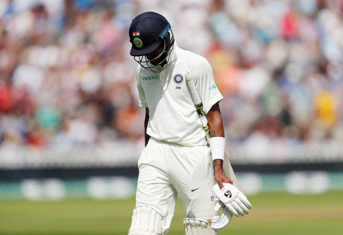 India's Hardik Pandya walks back dejected after his dismissal