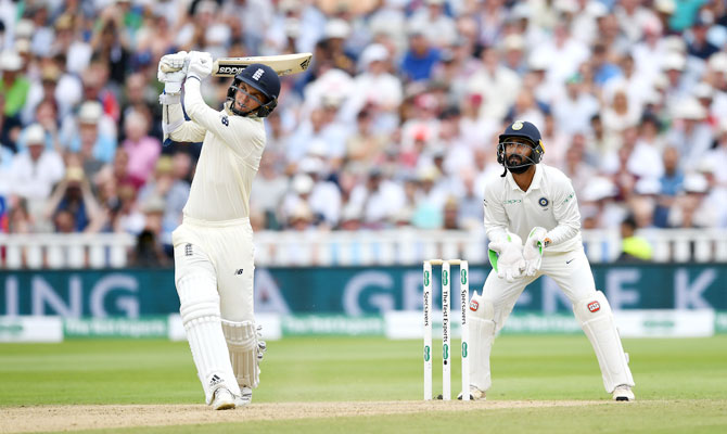 Sam Curran hits out for six runs watched India wicketkeeper Dinesh Karthik on Friday