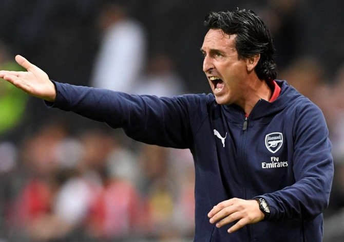Under-fire Arsenal coach gets club's backing, but...