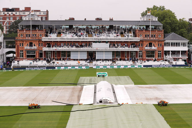 General view of covers on the pitch during a rain delay during the 2nd Test at Lord's in London on Thursday