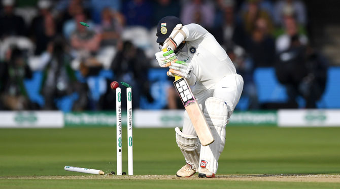 India's Dinesh Karthik is bowled by England's Sam Curran in the first innings of the Lord's Test on Friday