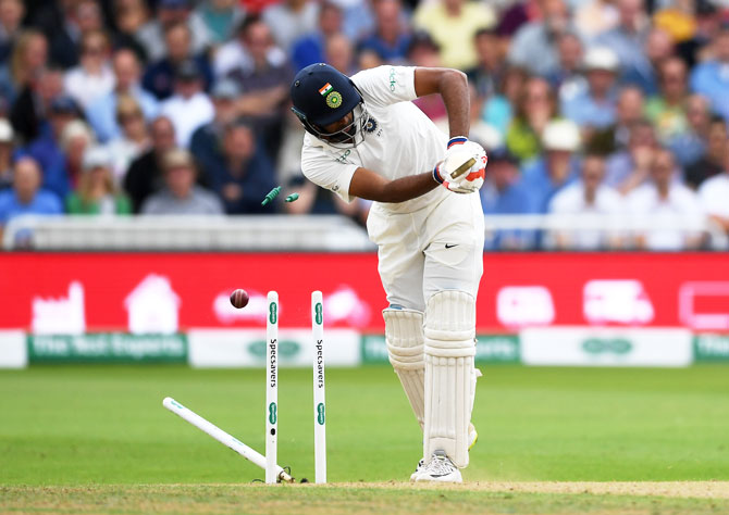 India's Ravichandran Ashwin is bowled by England's Stuart Broad