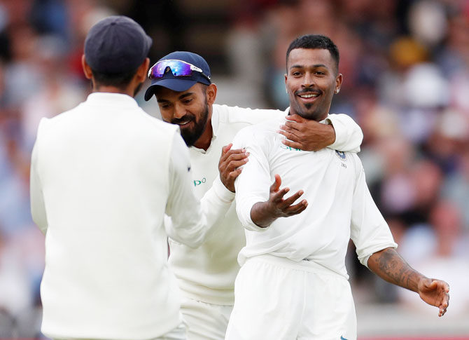 India's Hardik Pandya celebrates with teammates after taking the wicket of England's Stuart Broad