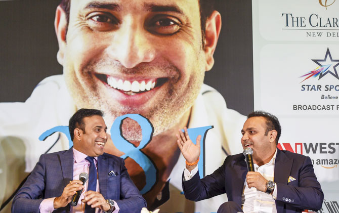 VVS Laxman and Virendra Sehwag chat during the book launch on Tuesday