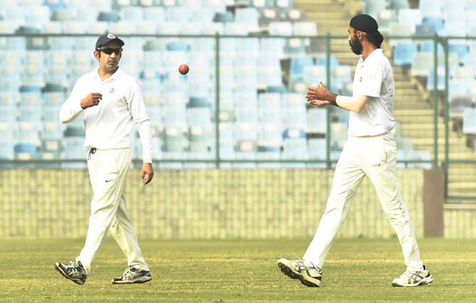 Delhi's Gautam Gambhir (left) in action during the Ranji Trophy match against Andhra Pradesh, his final cricket match, on Thursday