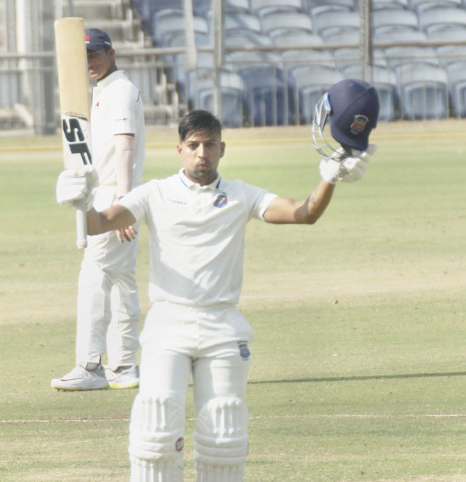 Maharashtra opener Swapnil Gugale celebrates his ton against Mumbai on Thursday