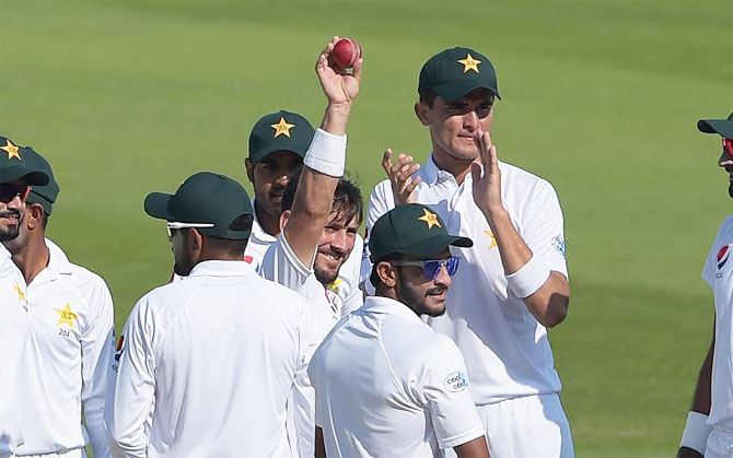 Yasir Shah celebrates after picking his 200th Test wicket during the 3rd Test against New Zealand on Thursday
