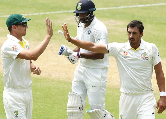 Mitchell Starc of Australia celebrates after taking the wicket of Ravichandran Ashwin in the Adelaide Test. Starc picked only five wickets in the opening Test against India