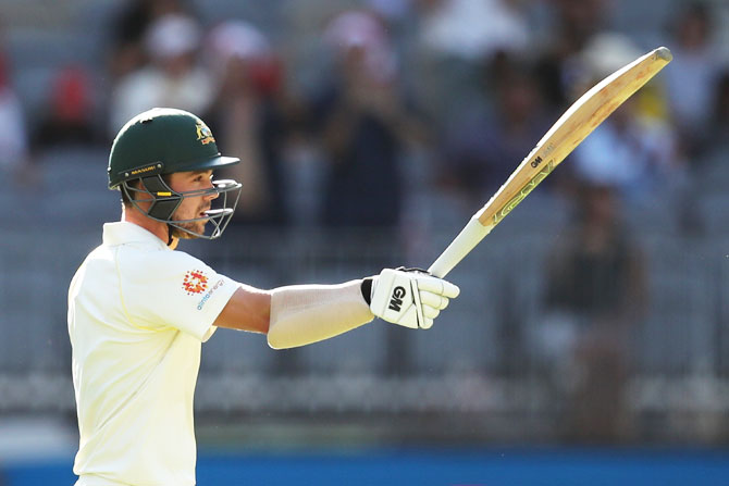 Rediff Cricket - Indian cricket - PHOTOS: Australia pegged back by India after steady start on Day 1