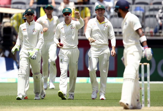 Kohli hits century but Australia on top