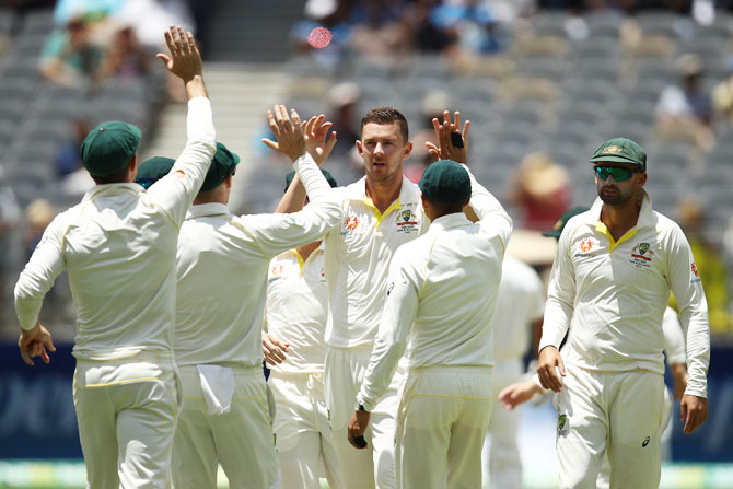 Australia's Josh Hazlewood celebrates after taking the wicket of India's Hanuma Vihari