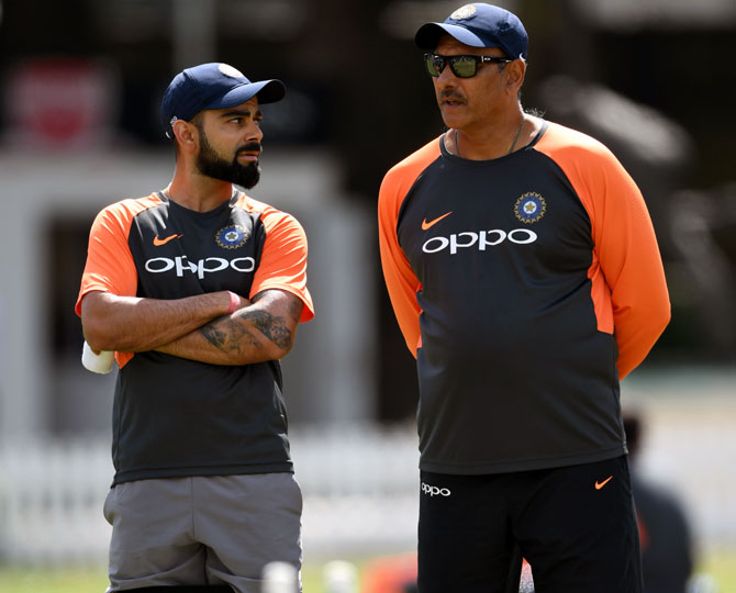 Shastri wins 'close race' to continue as India's coach