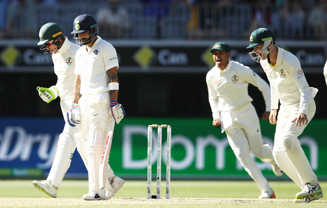 PHOTOS: Australia scent victory after India batsmen stutter