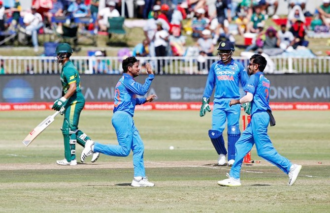 Kuldeep Yadav and Yuzvendra Chahal celebrate J P Duminy's wicket in the first ODI against South Africa, Durban, February 1, 2018. Photograph: Rogan Ward/Reuters