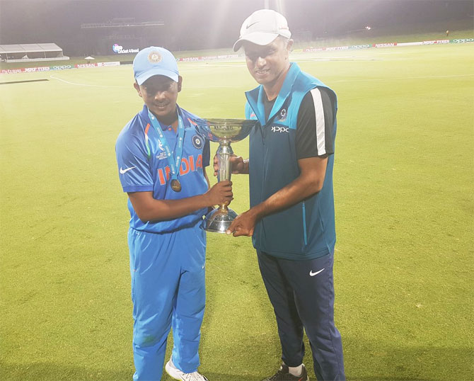 India Under-19 captain Prithvi Shaw and coach Rahul Dravid with the trophy