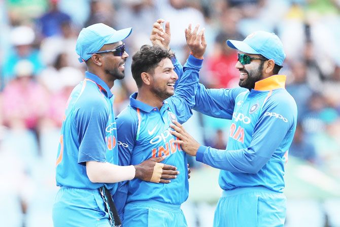 Kuldeep Yadav (centre) celebrates with teammates after picking the wicket of David Miller