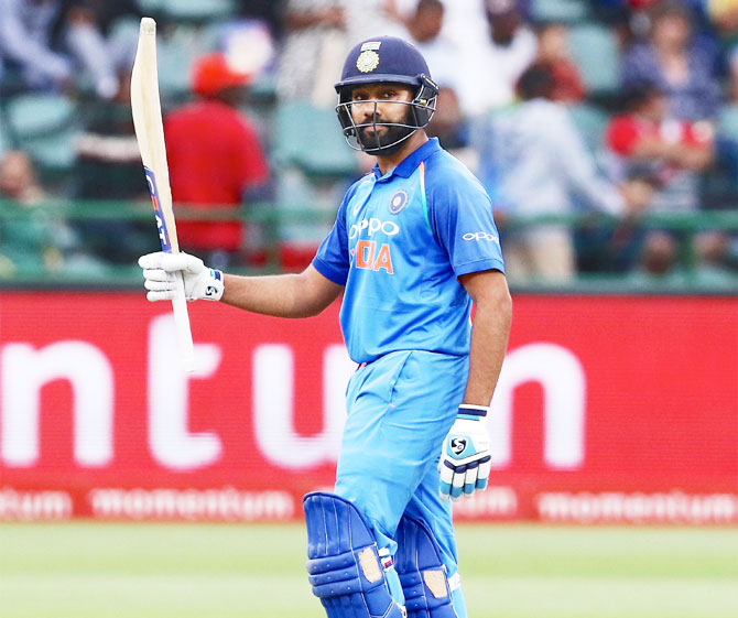 Rohit Sharma celebrates on reaching his match-winning century