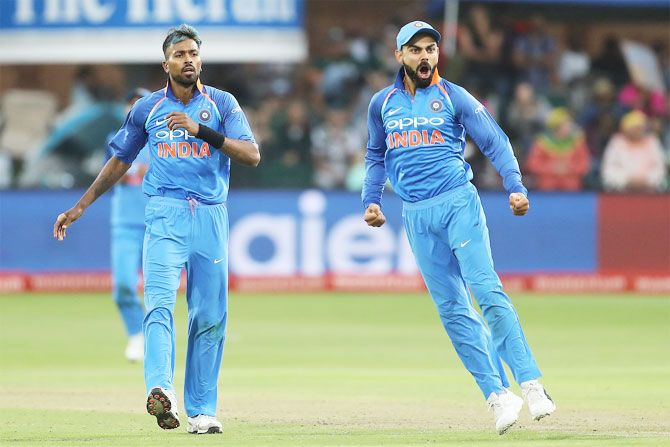 Virat Kohli and Hardik Pandya celebrate the wicket of Jean-Paul Duminy during the 5th ODI in Port Elizabeth on Tuesday