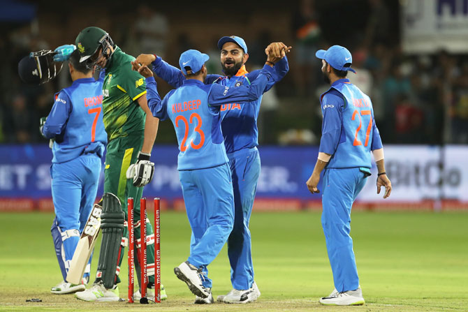 India captain Virat Kohli and his teammates celebrate victory over South Africa in the 5th ODI at Port Elizabeth on Tuesday