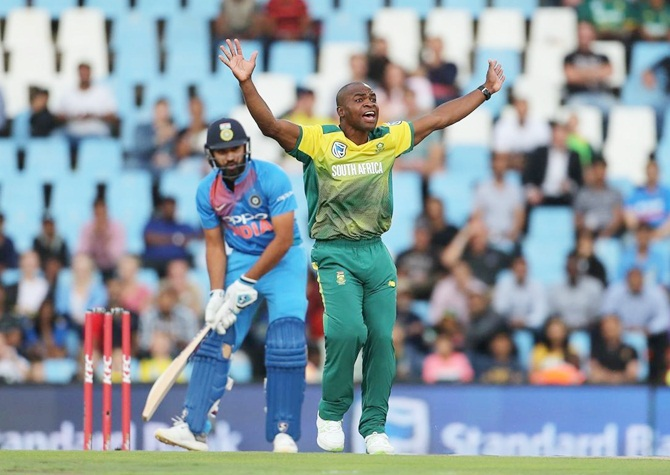 Rohit Sharma watches anxiously as South Africa pacer Junior Dala appeals for lbw.