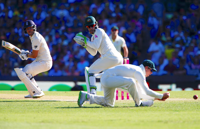 England's Dawid Malan watches as Australia's captain Steve Smith drops a catch