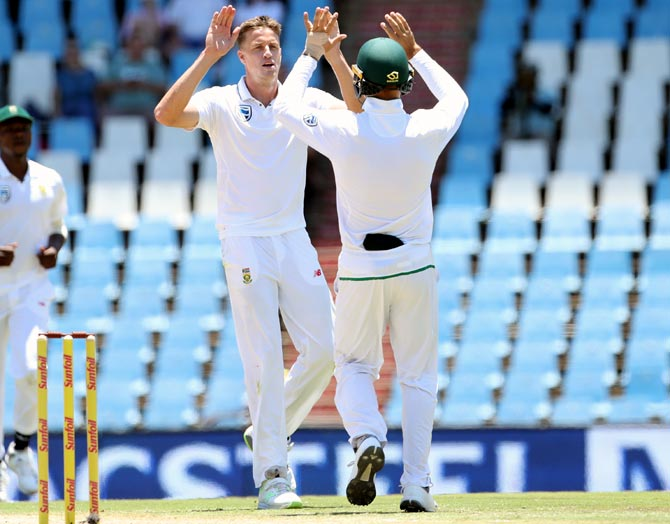 Morne Morkel, left, celebrates after taking the wicket of Mohammed Shami