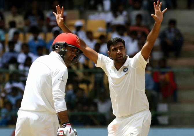 Afghanistan's players celebrate the wicket of Ravichandran Ashwin
