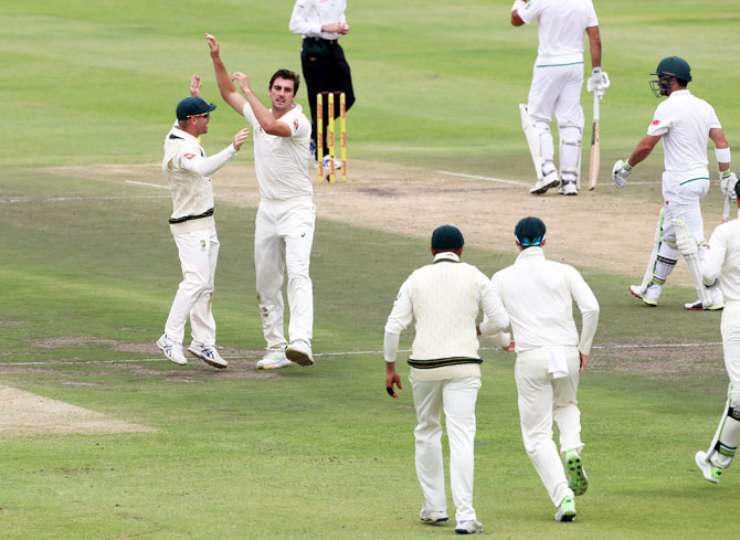 Australia's Pat Cummins and teammates celebrate the dismissal of South Africa's Dean Elgar