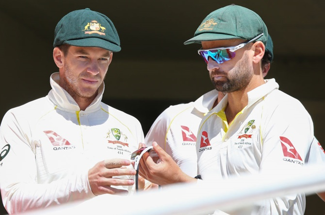 Tim Paine, left, with Nathan Lyon.