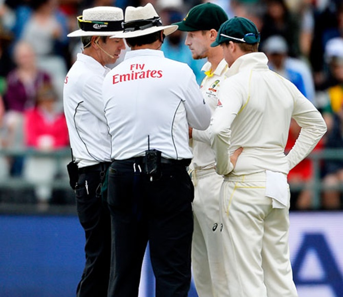 Australia's Cameron Bancroft and captain Steve Smith have a chat with the umpires on Day 3 of the 3rd Test in Cape Town after being caught for ball tampering. The duo, along with teammate David Warner were subsequently handed 12-month bans.