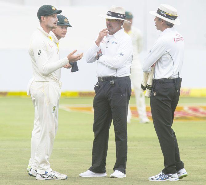 Umpires Nigel Llong and Richard Illingworth confront Australia's Cameron Bancroft on Day 3 of the third Sunfoil Test match against South Africa at PPC Newlands in Cape Town on Saturday