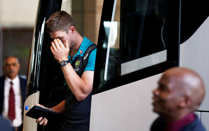 Australian cricketer Cameron Bancroft gestures as he arrives at a hotel in Sandton, South Africa on Tuesday