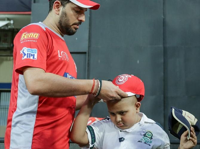 PIX: Yuvraj brings smile to a fan's face