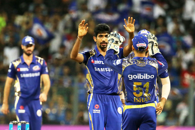 Mumbai Indians' Jasprit Bumrah celebrates the wicket of KXIP's Marcus Stoinis
