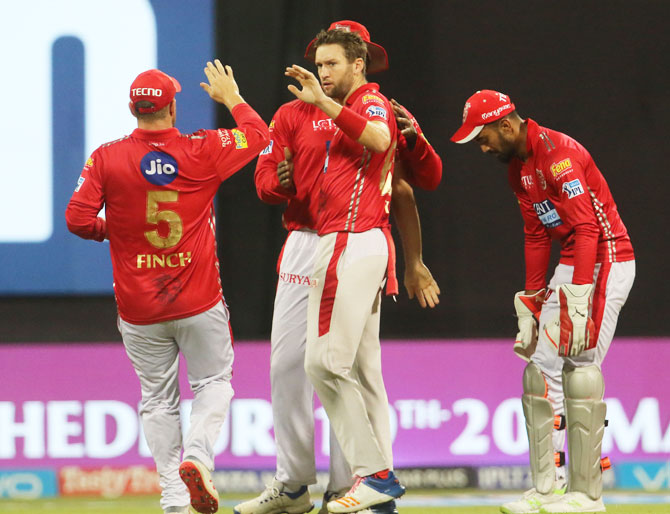 Kings XI Punjab players celebrate the wicket of Mumbai Indians' Evin Lewis