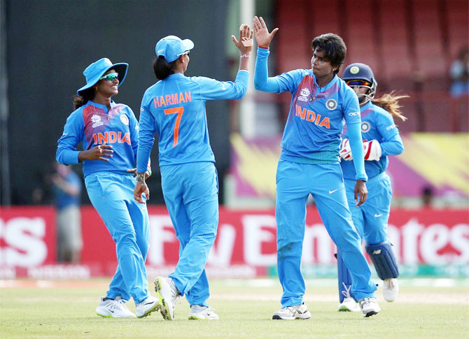 India players celebrate after dismissing a New Zealand batsman during their World T20 opener in Guyana on Friday