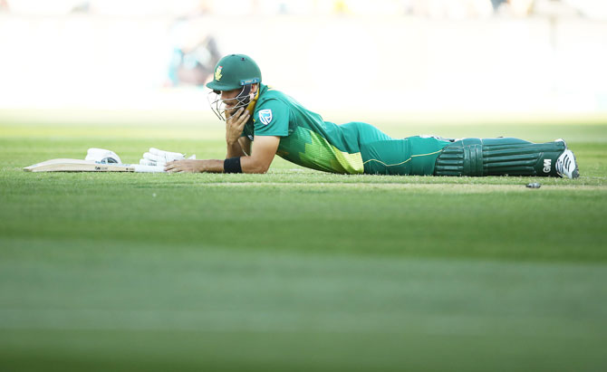 South Africa's Aiden Markram wears a dejected look after being run out by Australia's Marcus Stoinis