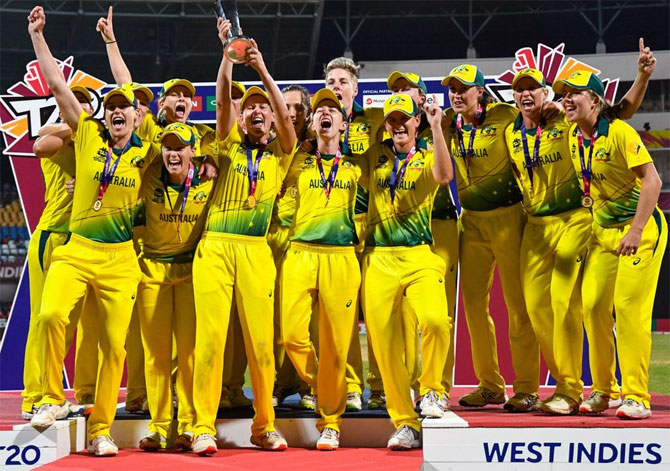 The Australian women's team celebrate after winning the Women's World T20 title on Saturday