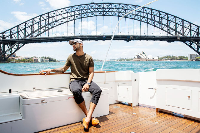 India opener Shikhar Dhawan enjoys a yatch ride as he goes past the Sydney Harbour Bridge and the Sydney Opera House in the background
