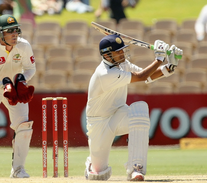 Rahul Dravid sweeps as Aussie wicket-keeper Brad Haddin looks on, the Adelaide Oval, January 27, 2012.