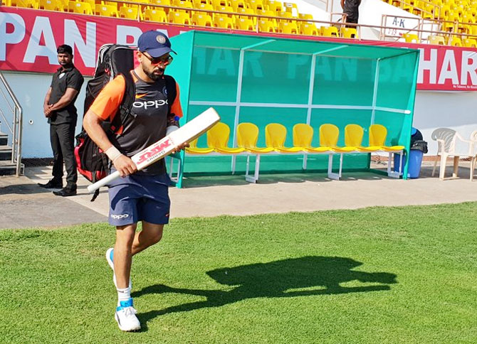 India captain Virat Kohli walks out for a training session on Wednesday