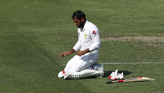 Pakistan's Mohammad Hafeez celebrates after reaching his century during day one of the first Test against Australia at Dubai International Stadium in Dubai, United Arab Emirates on Sunday