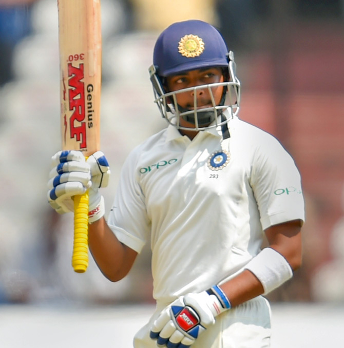 Prithvi Shaw celebrates after completing his half-century