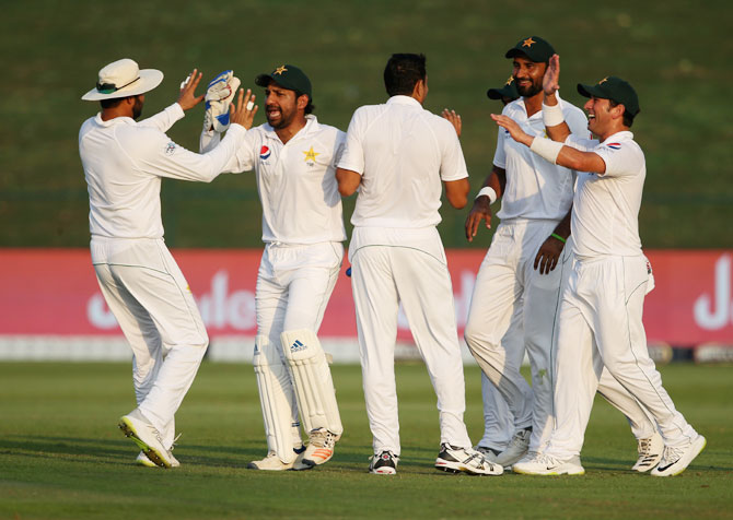 Players of Pakistan celebrates the wicket of Australia's Usman Khawaja on Day 1 of the 2nd Test at Sheikh Zayed stadium in Abu Dhabi, United Arab Emirates on Tuesday