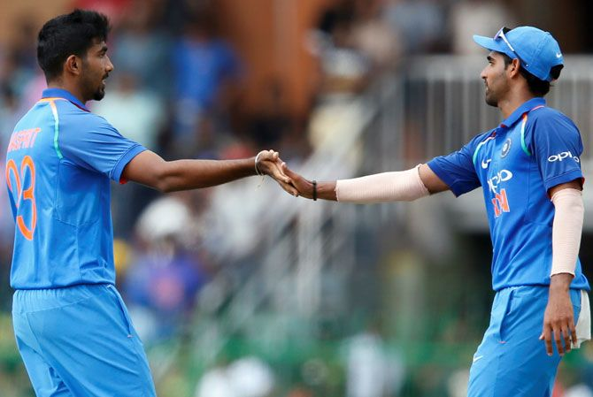 Jasprit Bumrah, left, and Bhuvneshwar Kumar lead India's best bowling attack in a World Cup. Photograph: Dinuka Liyanawatte/Reuters