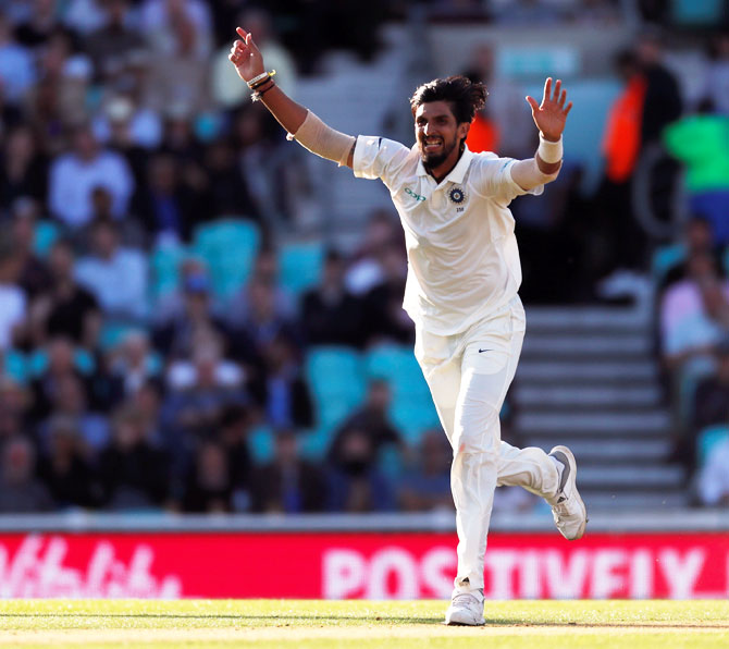 India's Ishant Sharma celebrates the wicket of England's Moeen Ali